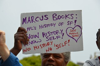 People pray for Marcus Books at new owner of building's church | by Steve Rhodes