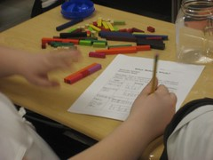 What fractions sum to one whole? Line up different lengths of fraction rods and write a number sentence for it. (March 2011, Gr 5)