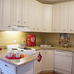 Granite countertops and white cabinets are such a kitchen treat. Just add cookies for a little extra sweet.