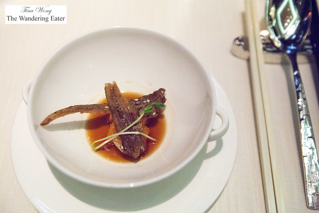 Amuse bouche of fried anchov, Japanaese yam and fish sauce