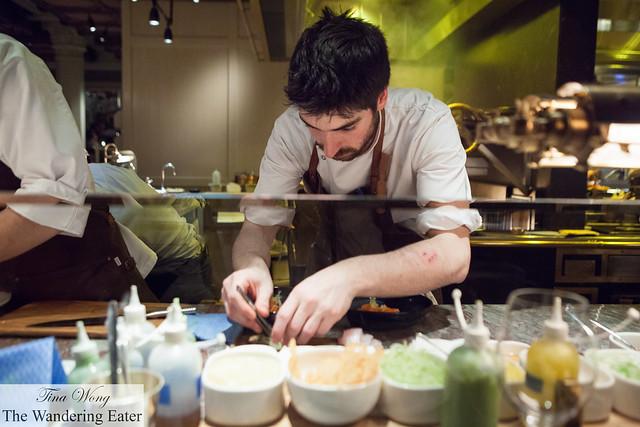 Chef plating at the bar