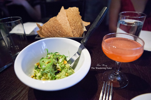 Pistachio guacamole served with Masa chips (background) and Siesta cocktail