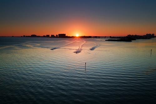sunset race bay unitedstates florida jetski watercraft sunsetandsunrises absolutelystunningscapes