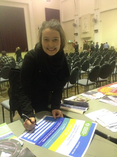 Camille Sydow (Animal Justice Party) signing ACF climate pledge at Wills2016 climate forum
