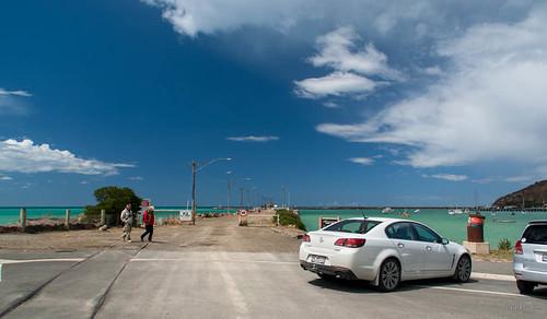 sea newzealand sky people cars clouds hills southisland oamaru tripdownsouth harbourtynestreetarea
