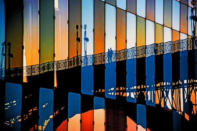 Two pedestrians on the Old Bridge