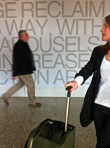 iphone lofi lowrez mophone phonecam text graphic airport tullamrine tullamarineairport melbourneinternationalairport wating passenger luggage arrivalshall neodocumentary woman man walking standing bluured pc3045 auspctaggedpc3045 melpc3045 blurred hipshot fromthehip vertical aaronsiskind aaron siskinf fltr people strangers portraits trove australiainpictures troveaus unfound art