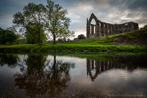 sunset reflection building tree water abbey graveyard grass clouds river landscape religious scenery yorkshire ruin pebbles bolton wharfe