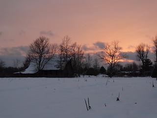 Sunset on a snowscape with a barn. | by Gerald Barnett