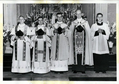 4 priests and 1 altar server in a pose