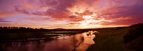 light sky sun wet clouds sunrise reflections river gold shine shropshire bright severn fields