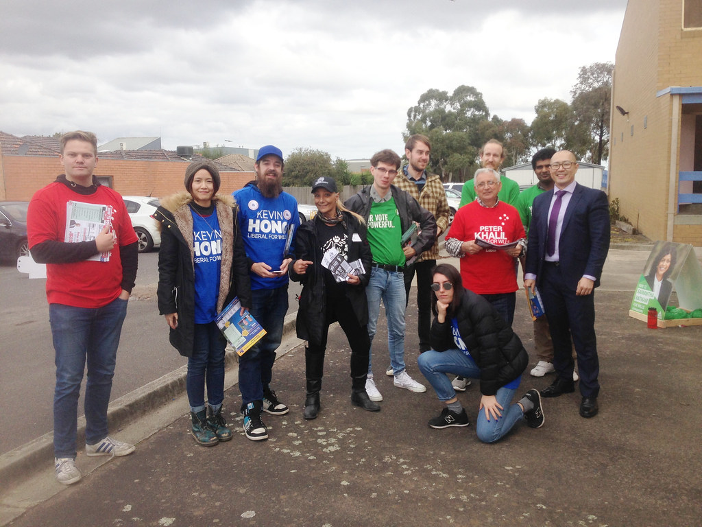Group photo: ALP, Greens, Liberal and AJP booth workers with Liberal candidate Kevin Hong - Fawkner #Wills2016 #Ausvotes