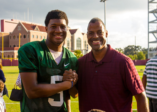 Volunteer guardian ad litem and community supporter Omega Wynn with Florida State Seminoles quarterback Jameis Winston (5) at the Albert J. Dunlap Athletic Training Facility football practice fields in Tallahassee, Florida on October 8, 2013. | by flguardian2