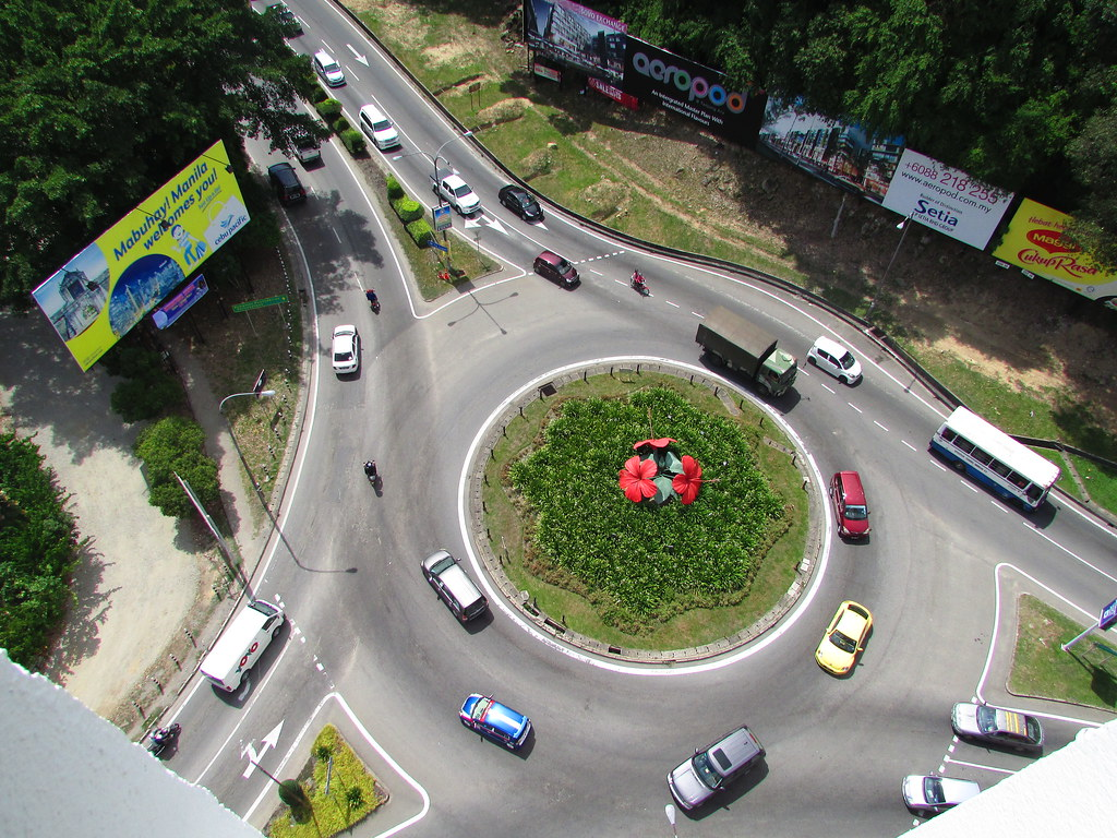The Cars At The Roundabout Go Round and Round...