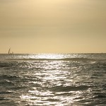 Setting sun, sailing boat, Oahu
