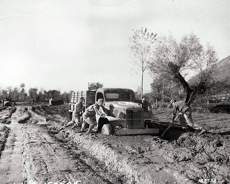 Soldiers try to extract a truck from the mud