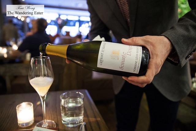 """Pouring Crémant d'Alsace, Domaine Leon Boesch, """"Soixante Douze,"""" Alsace, France"""