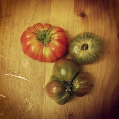 Heirloom tomatos on dirty cutting board