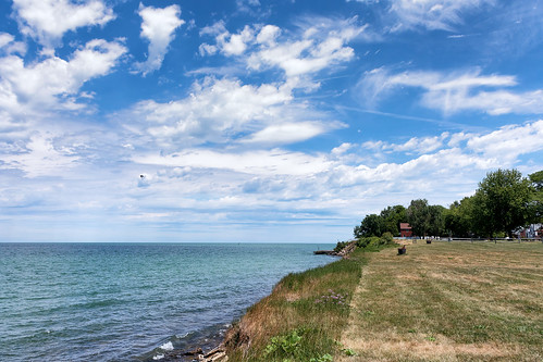 trees ohio sky house lake water clouds landscape coast lakeerie outdoor cleveland shore rield
