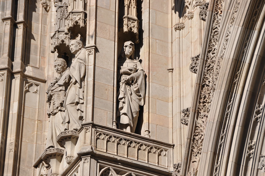 Barcelona. Cathedral church of the Holy Cross and Saint Eulalia. Neo-Gothic facade. Saints Maria of Cervelló, Joseph Oriol and Raymond of Penyafort. 1887-1890. Eduard Batiste Alentorn, sculptor