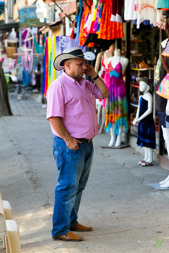 camera pink vacation man hat shirt canon eos costarica cowboy phone boots stripes events streetphotography cell places equipment jeans coco cameras 7d processing handheld 200views 50views lenses topaz riu guanacaste 25views niksoftware bypaulchambers canonef2470mmf28iiusm lightroom4 photoshopcs6 rocksteadyimages