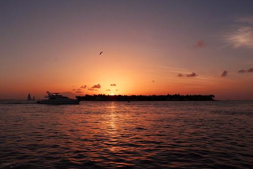 light sunset shadow red sea sky orange usa sun seascape reflection nature water silhouette clouds america dark landscape evening boat us nuvole waves ray ship unitedstates dusk natura cielo caribbean paesaggio statiuniti andreamoscato