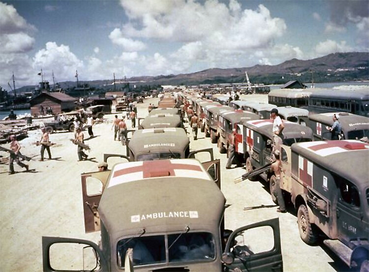 View of military ambulances lined up on shore at Guam