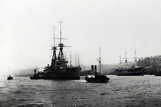 The battleship HMS 'Superb' passing North Shields