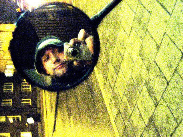 Walking home at night selfie in rearview mirror on urban street MushroomBrain portrait