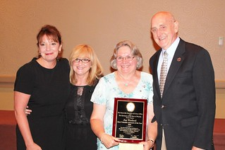 """Volunteer guardian ad litem Janet """"Jan"""" Watford (third from left) with Deborah Moore, sister Cookie and husband Jim at the Statewide Guardian ad Litem Program awards reception on August 28, 2013 in Orlando, Florida. 