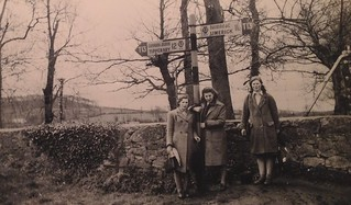 Mum with Kitty and Hannah  Mulcahy of   Rathwood, Abington,  co Limerick,  Ireland, 1948, old automobile association signpost on a walk Trunk road 13 T13 , midway Tipperary and Limerick