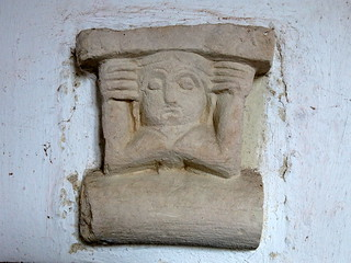A 12th C. corbel, set into the the south porch wall, the Church of St John the Baptist, Badingham, Suffolk, England
