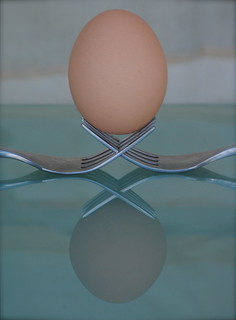 Traditional Egg balanced on Forks | by Clint__Budd