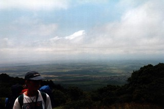 Ruth and view from Mount Meru's lower slopes, Tanzania