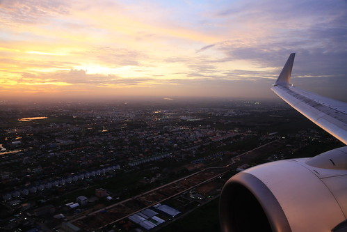 travel sunset sky window plane evening flying airport asia view bangkok aircraft seat flight wing engine winglet donmuang nokair b738