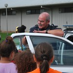 July 24, 2015 - 08:56 - Cpl Michael Swords visiting and showing off is patrol car to a group of kids from St. Jules Elementary Credit: Traci Landry, St. Mary Parish Sheriff's Office