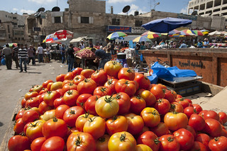 Tomato stand in market near Ramallah's main mosque   by World Bank Photo Collection
