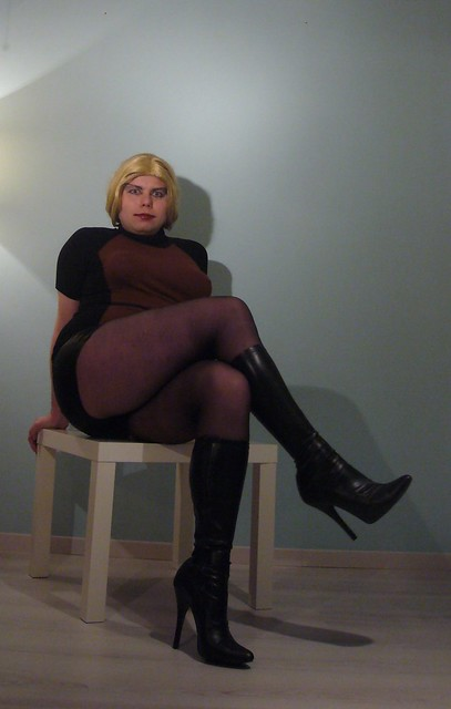 blonde in hotpants and boots