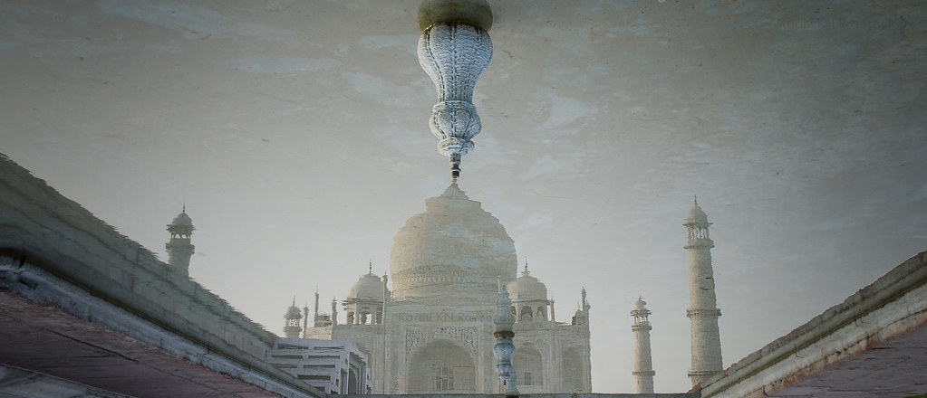 reflection of Taj on a fountain pool