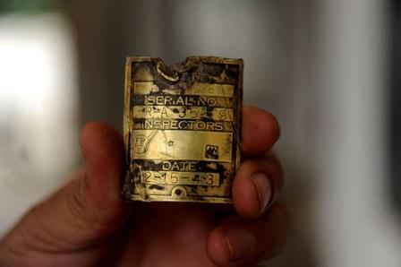 Placa de bronce hallada en el aparato de Tigre Volador