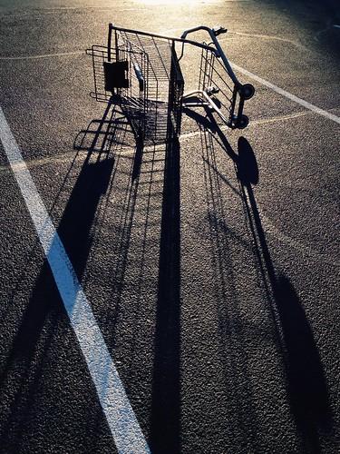 sunset shadow silhouette parkinglot shoppingcart