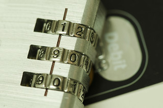 Combination Lock on top of a Credit card e.g. Credit Card Security | by perspec_photo88