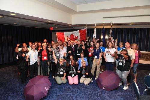 Females Posing with Canadian Flag / Femmes devant un drapeau canadien