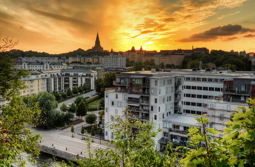 trees houses sunset sky streets tower cars church water leaves sign skyline night clouds docks buildings cityscape cloudy sweden stockholm södermalm balconies sverige norra hdr treet sofiakyrka henriksdalsberget hammarbyhamnen