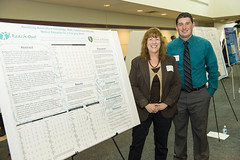 MPH student Seth VanZant with CE Chair Sharon Sherlock during poster presentation