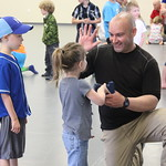 April 16, 2016 - 11:33 - Sgt. Tyson Kilbey high fives a young participant after she successfully demonstrates how to safely and correctly handle a firearm.  Sgt. Kilbey helped coordinate a Kids Handgun Safety & Awareness class for kids ages 5-12, where they learned the four cardinal rules to firearms safety and what to do if they ever come across a firearm. Credit: Claire Young, Johnson County KS Sheriff's Office