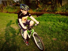 The Boy on his bike. It's a little small now. Seems I'm in the market for a kids bike.
