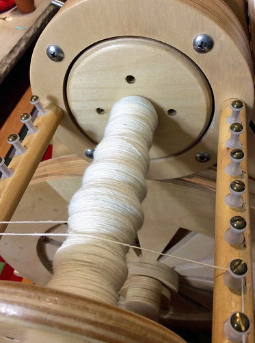 Spinning single undyed Polwarth wool yarn by irieknit on Spinolution Mach 2 spinning wheel flyer detail