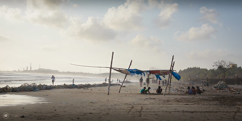 sunset sea people india mist beach clouds children sand maharashtra serene shelter sandcastle tarpaulin in dandi dandibeach