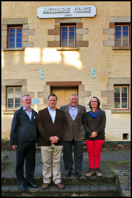 Albert, Pete, Helen Geoff outside Maq house with building name but not great pic of Helen